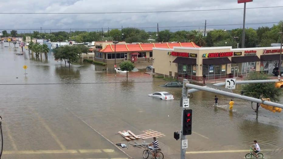 Rescue teams overwhelmed as rain continues in Houston