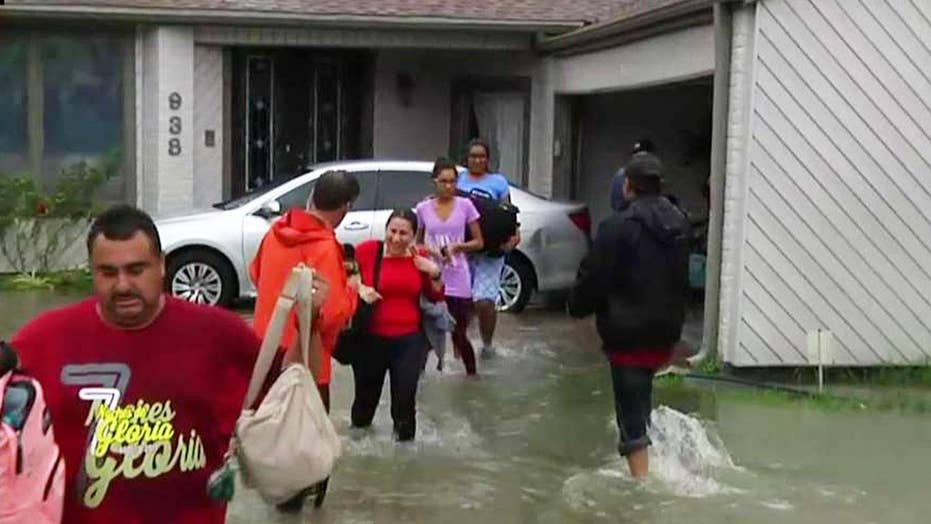 Overflow from Houston reservoir forces families to evacuate