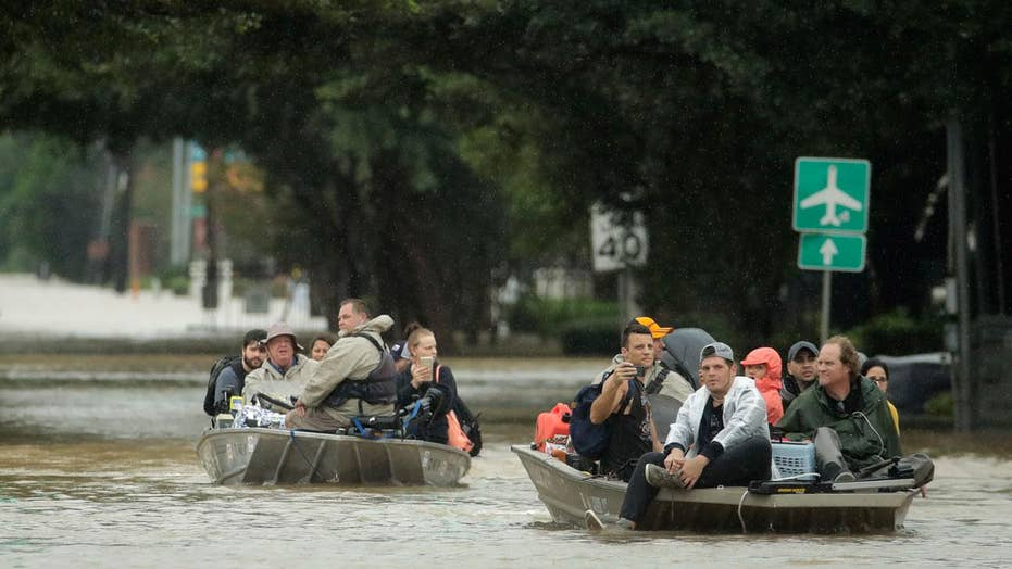 Thousands rescued in Houston as floodwaters rise