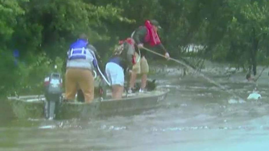 Texas man rescued by boat after clinging to tree for hours