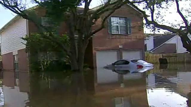 Houston tries to save some areas by flooding others