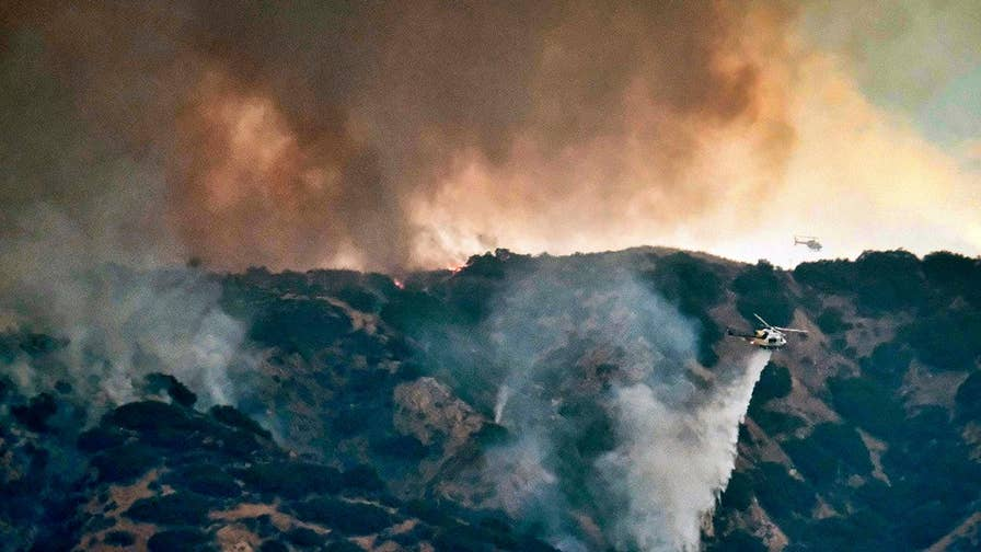 Firefighters battle inferno described as the largest in Los Angeles' history