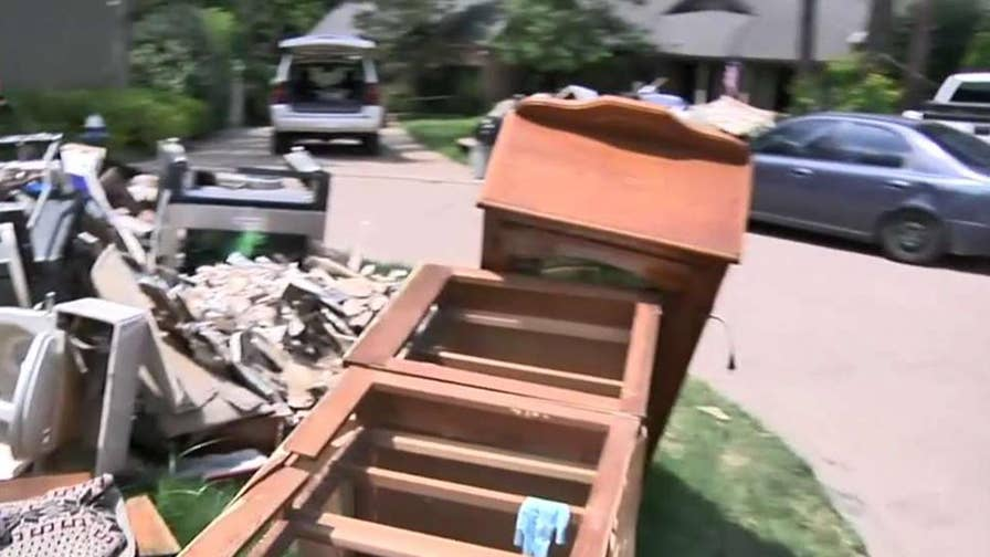 Houston homeowners struggle to protect belongings they hope to salvage; Matt Finn reports