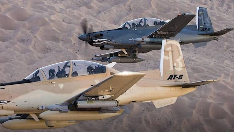 Defense Specialist Allison Barrie shares an insider's look into the AT-6 Wolverine and reveals how this retro-looking hybrid can closely support U.S. troops on the ground by providing a wide variety of firepower from the air