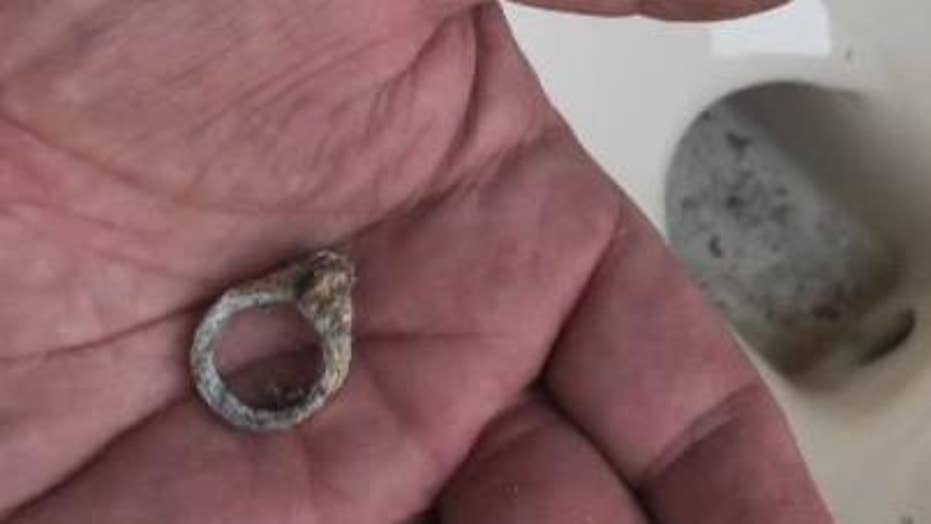 Couple finds long lost wedding ring in toilet during remodel