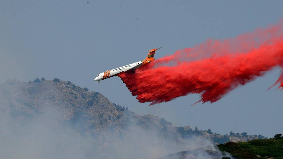 Nearly 100 wildfires burning out west