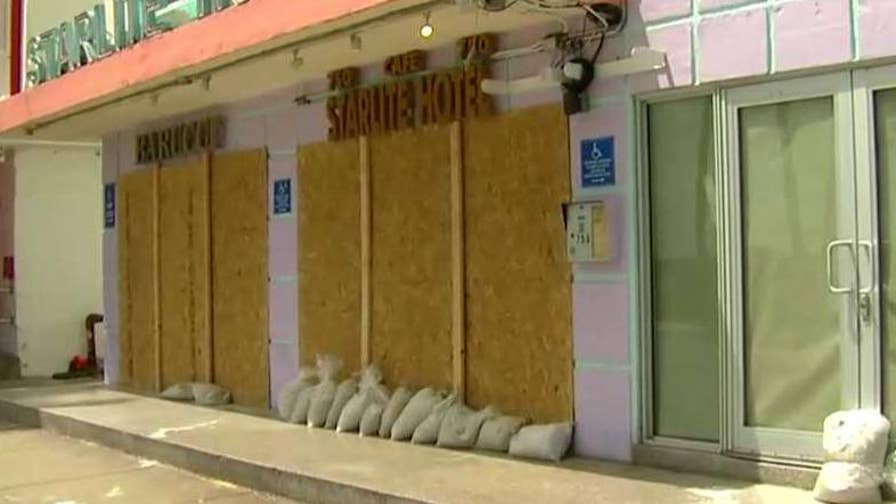 Restaurants, stores boarded up in preparation for the storm