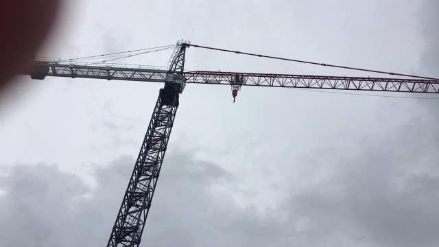 Miami construction cranes spin in Hurricane Irma's winds