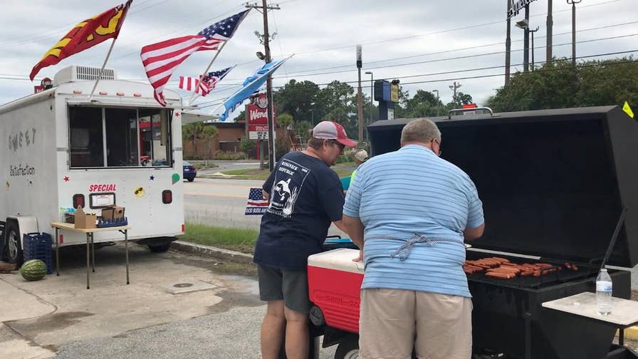 Volunteers gather to cook and feed evacuees in Valdosta, Georgia
