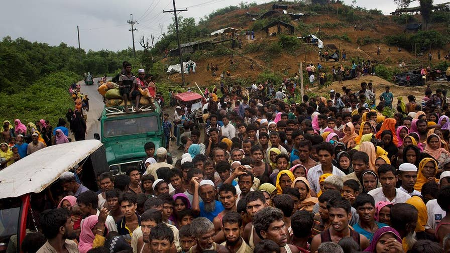 At least 370,000 of Muslim refugees have flooded into Bangladesh over the past two and a half weeks to escape recent violence in Buddhist-majority Burma
