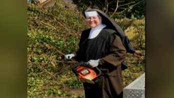 A chainsaw-wielding Florida nun, in full habit, does her part in the Hurricane Irma clean-up effort