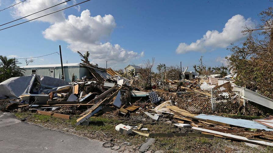 Residents receive critical supplies in the hurricane's aftermath