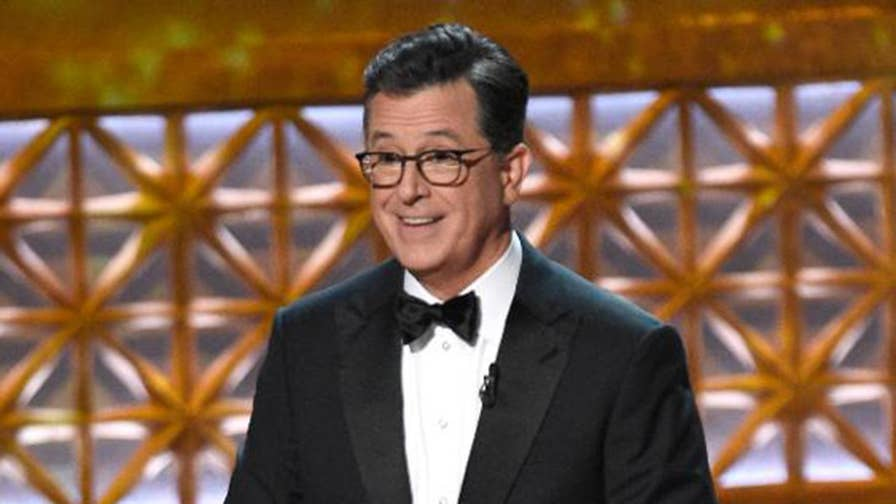 Emmy host Stephen Colbert gets political in his opening monologue. Colbert takes aim at President Trump and Senator Ted Cruz and is joined on-stage by Sean Spicer