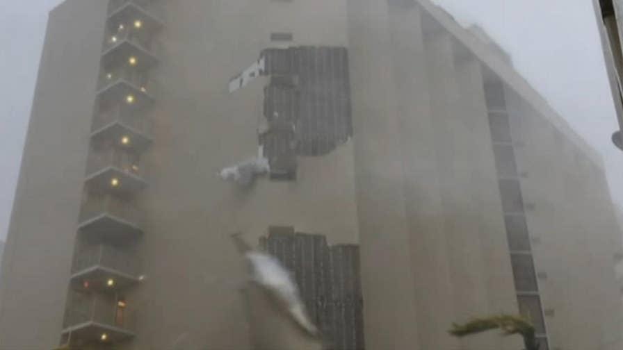 Hurricane Maria's winds rip side off building in San Juan