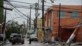 Hurricane Maria regained major hurricane status early Thursday, strengthening to a Category 3 storm, as it left a devastated -- and completely powerless -- Puerto Rico in its wake and at least 15 dead people in Dominica.