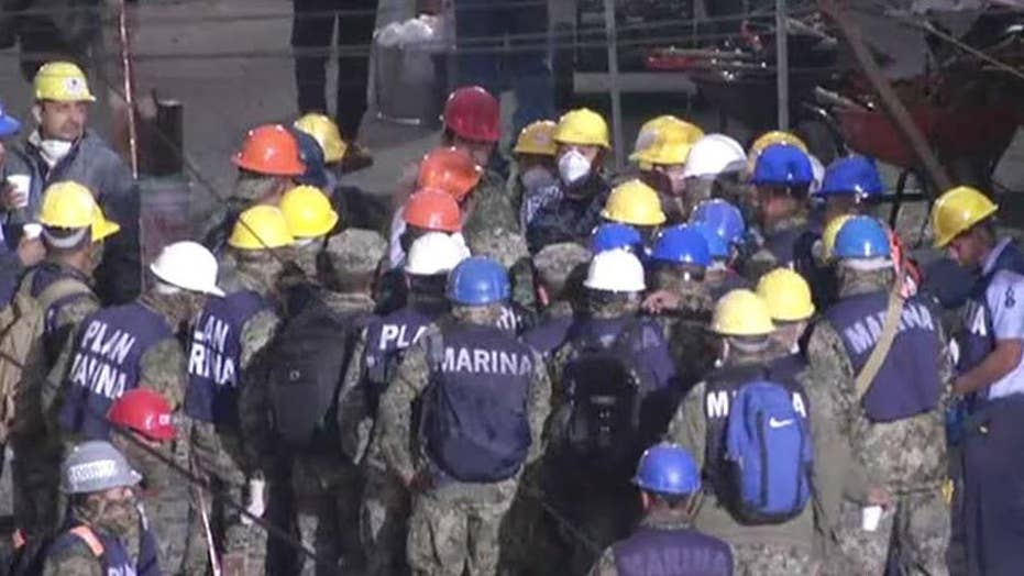 Crews race against time to rescue trapped children