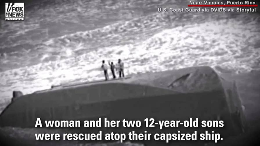 The US Coast Guard and British Royal Navy save a woman and two children from a capsized vessel after Hurricane Maria. The dramatic rescue was caught on tape