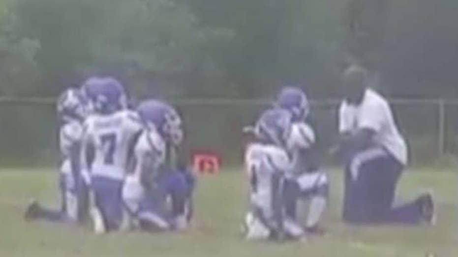 Youth football team kneels in Kaepernick-inspired protest