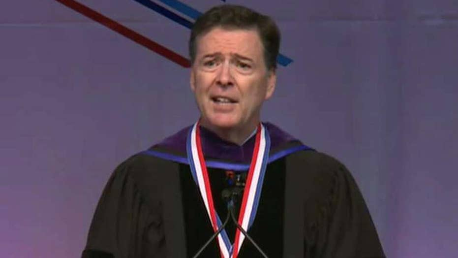 Protesters interrupt speech by former FBI chief James Comey