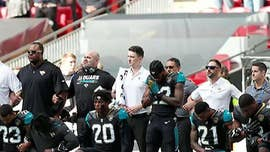 Three NFL teams stayed in their locker rooms during the national anthem ahead of NFL games on Sunday, as a growing number of players from other teams joined in protest by kneeling on the field.