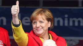 Germany's Social Democratic Party said Sunday its members have voted in favor of joining a coalition with Angela Merkel's conservative bloc, clearing the last major hurdle to the formation of a new government and a fourth term for the veteran German chancellor.