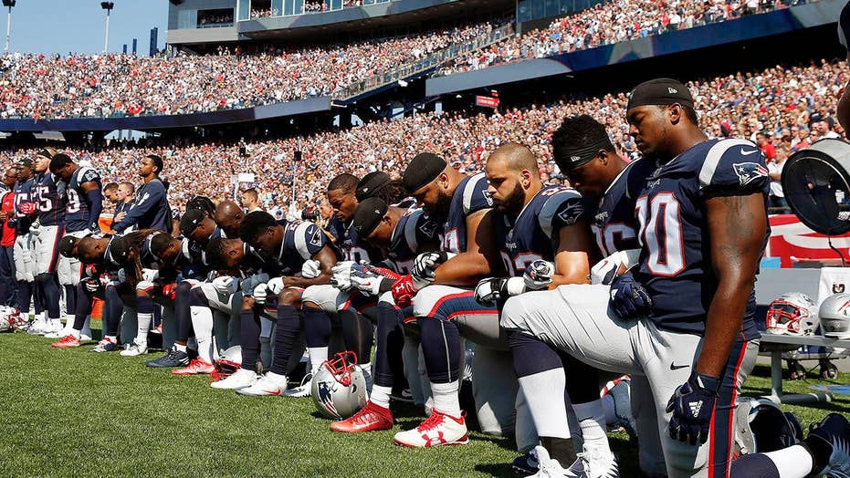 Politics and sports collide as anthem protests sweep NFL