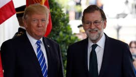 President Donald Trump holds a joint press conference with Spanish Prime Minister Mariano Rajoy at the White House's Rose Garden.