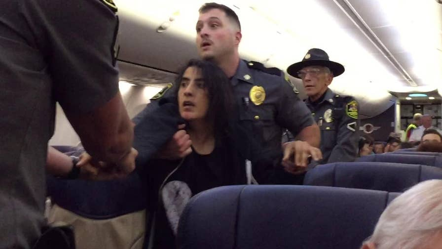 Southwest airlines apologized after video of a woman being forcefully removed from a flight goes viral