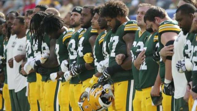 Green Bay Packers ask fans to lock arms during anthem