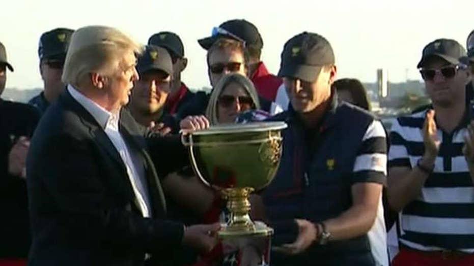 Trump dedicates golf trophy to people of Puerto Rico