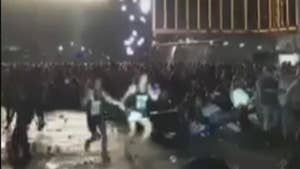 Raw video: Route 91 Harvest Festival concertgoers run for cover as 64-year-old Stephen Paddock opens fire from the 32nd floor of the Mandalay Bay Resort and Casino in Las Vegas.