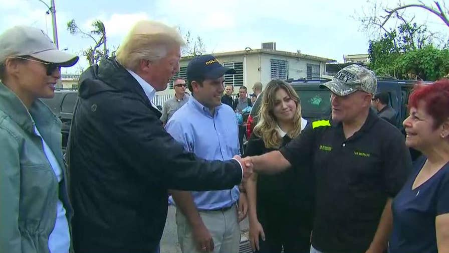 President surveys damage in San Juan with first responders, local officials and the first lady.