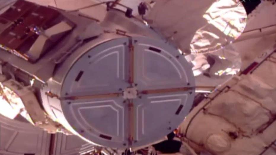 ISS astronauts begin first of three scheduled spacewalks