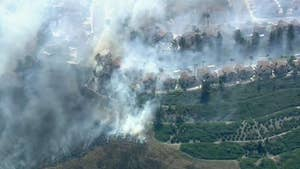 Wind-driven wildfire threatens homes in Anaheim, California