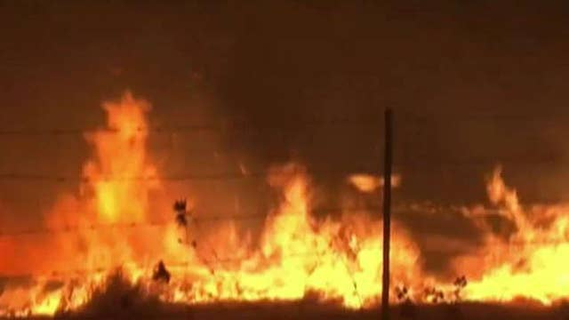 Raging wildfires rip through California wine country