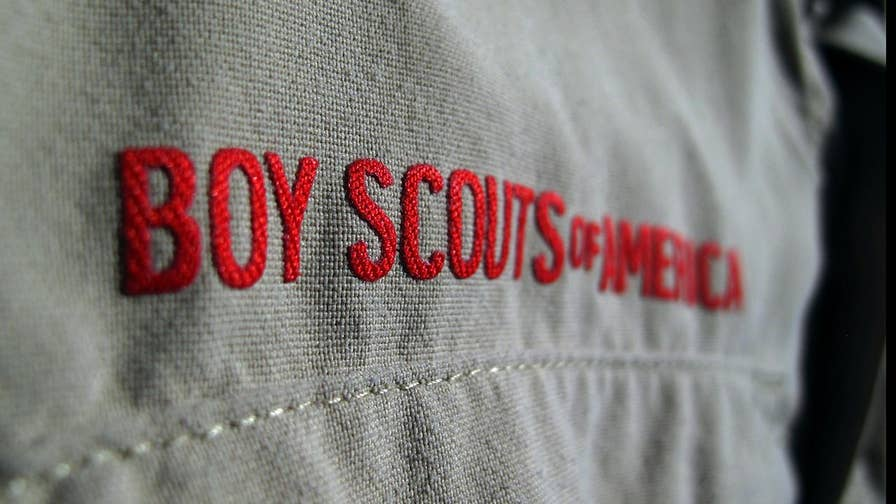 Girl Scouts of America accuses Boy Scouts organization of raiding its ranks due to financial problems.