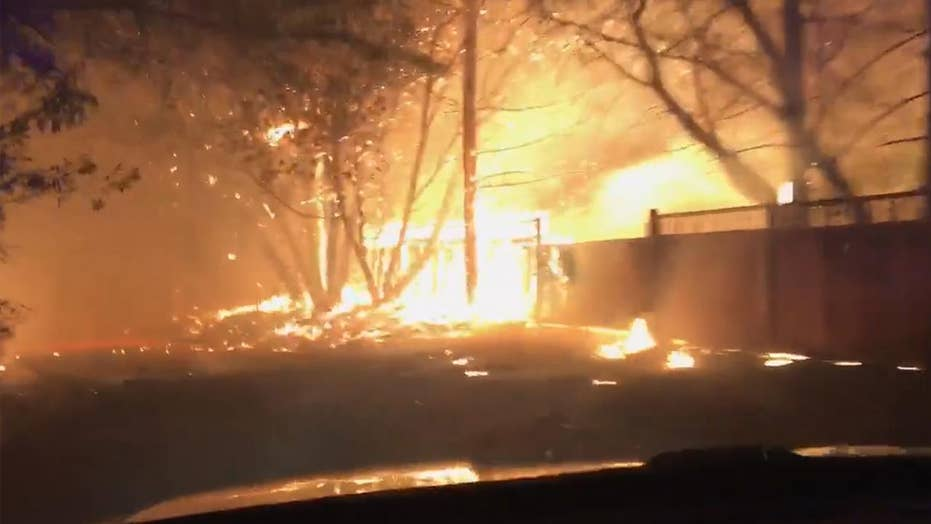 Police officer drives through raging wildfire in California