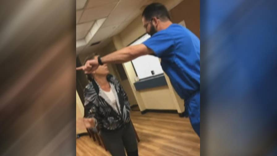 Raw video: Daughter records tense exchange at doctor's office in Gainesville, Florida