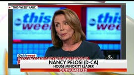 "California Rep. Nancy Pelosi says she must remain as the House Democrat leader to ensure a ""top woman"" is at the negotiating table, amid mounting calls within the party for changes in leadership."