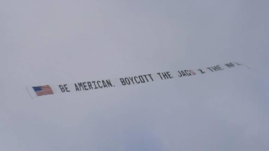 Terry Smiley purchases plane to fly over game in Jacksonville because he's fed up with national anthem protests.