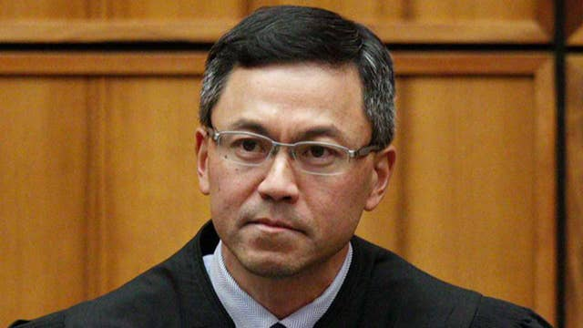 Hawaii judge blocks Trump's latest travel ban