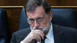 Spanish Prime Minister Mariano Rajoy says he has approved the implementation of Article 155 under Spain's constitution that would strip Catalonia of its autonomous powers and seeks to call an early election.