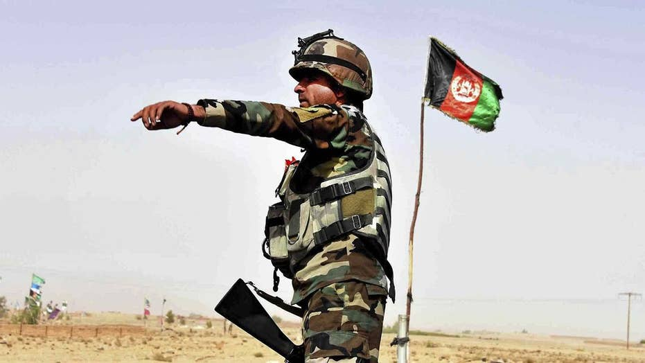 Taliban launch deadly assault on Afghan base