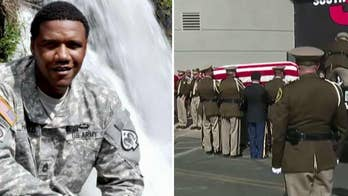 Charleston Hartfield is honored by the Nevada National Guard during memorial service.