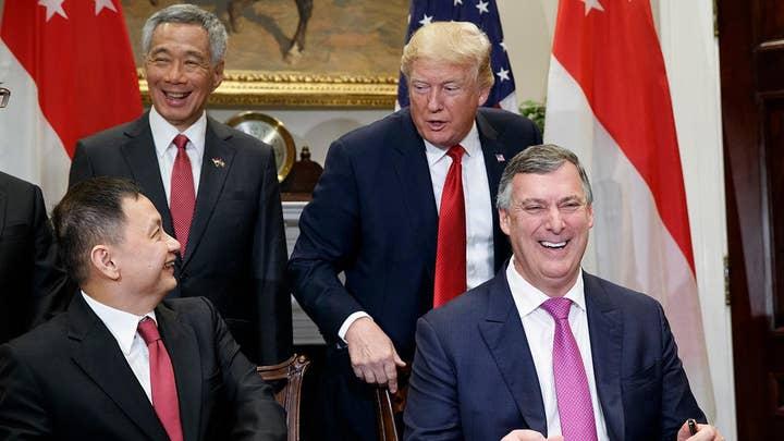 Trump celebrates Singapore-Boeing deal, awaits budget vote