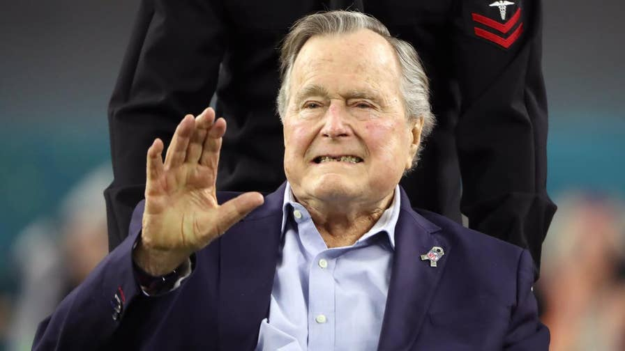 Former President George H.W. Bush apologizes after actress Heather Lind accused him of 'sexually assaulting' her during a screening four years ago.