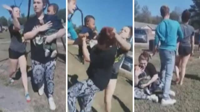 Warning, graphic language: Woman holding baby assaulted