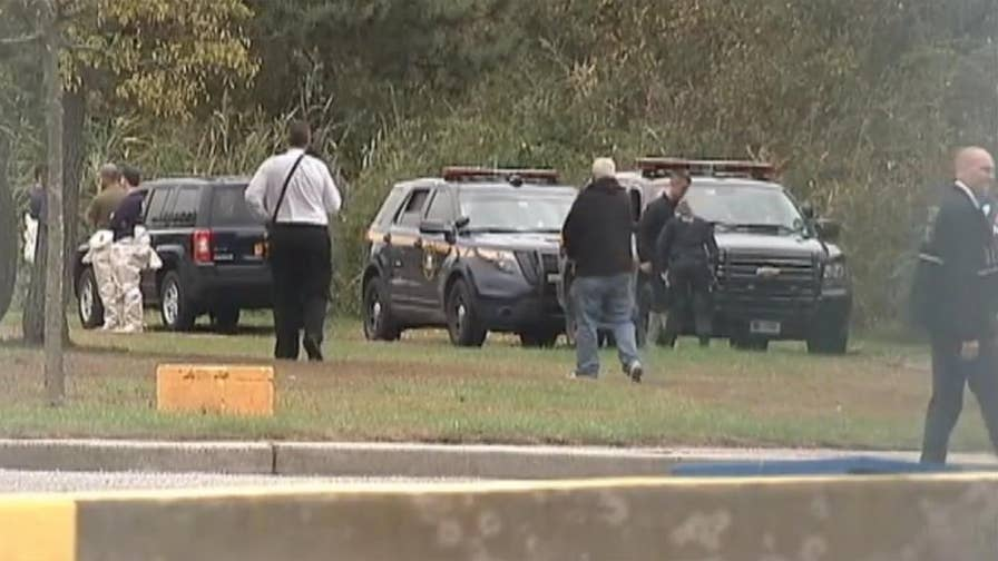 Law enforcement authorities descend on marsh where human remains were found.