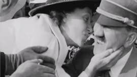 Striking images capture the moment an American woman kissed Hitler - leaving him so enraged he reportedly fired all his security guards for his failure to thwart her.