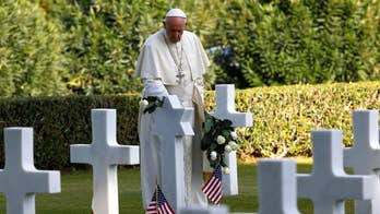 Pope Francis walked among the gravestones of an American military cemetery in Rome.  The Pontiff laid white roses and prayed to commemorate the Catholic All Souls' Day.